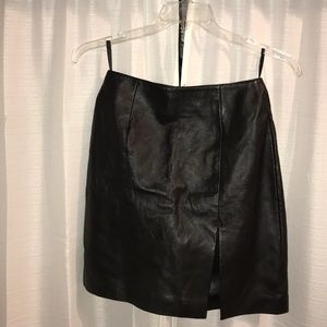 Black real leather skirt. Size 6 but more of a 4-2
